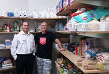 Staff from Nelson Community Ministries are loving donations from the Foodbank Project