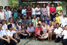 Mjr Vyvyenne Noakes with widows and elderly people helped at the Bagong Silong Corps feeding programme.