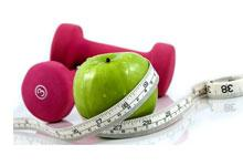 some weights, fruit and a tape measure
