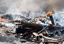 a large pit of rubbish on fire