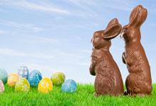 2 chocolate rabbits with easter eggs