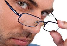 a man peering over his spectacles