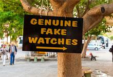 a sign saying genuine fake watches