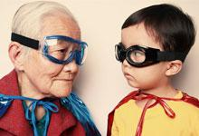 an old lady and young child dressed in superhero outfits
