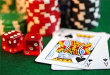 cards, dice and gambling chips