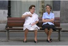 Two elderly ladies sitting on a bench