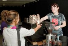 Salvation Army youth serving fair trade coffee; photo by Luke Tearle