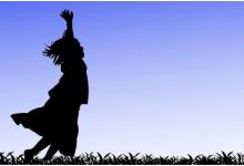 Girl running through field