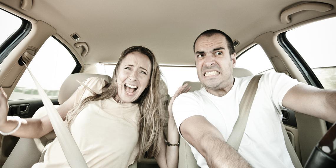 two people looking feraful in a car