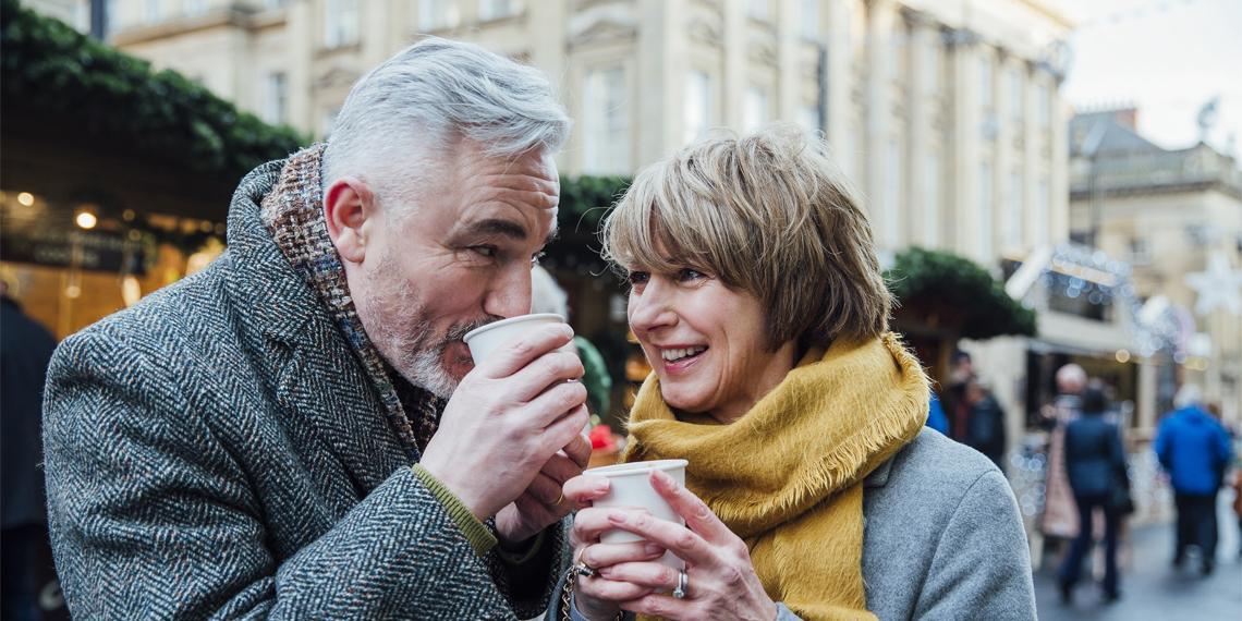 an older couple enjoynig coffee together