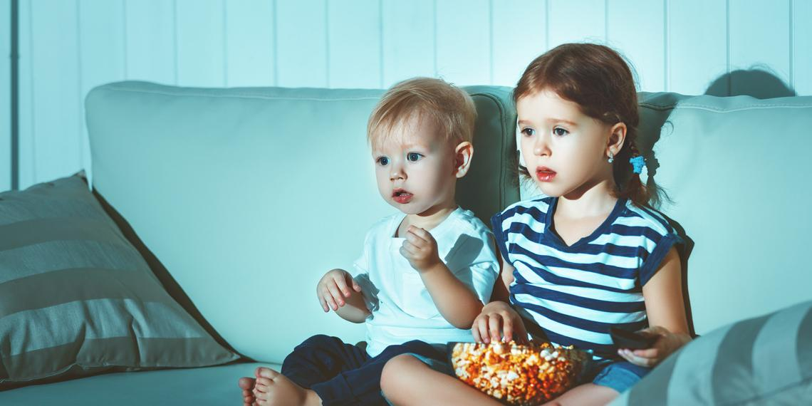 children watching a screen