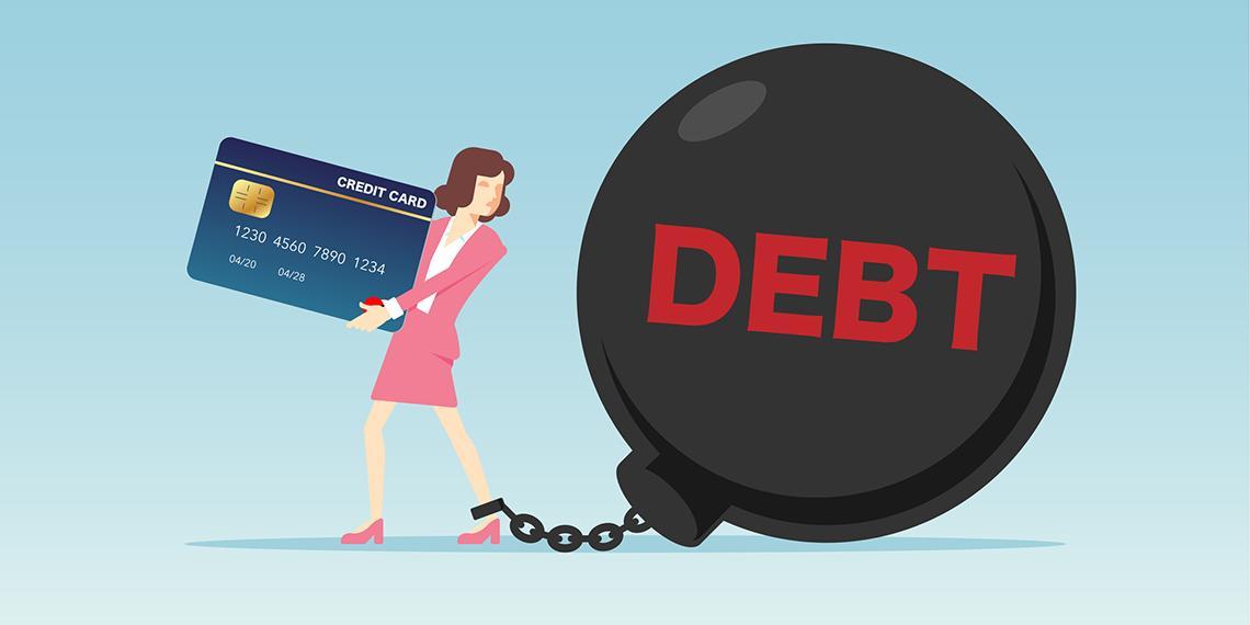 a woman dragging a ball titled debt