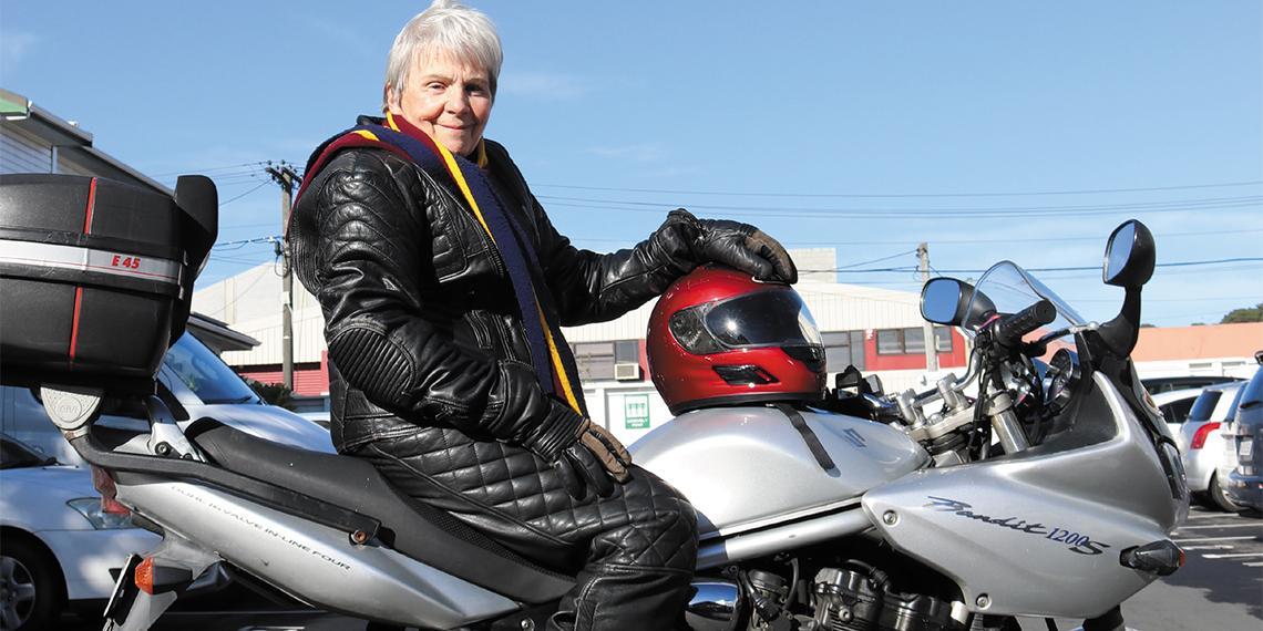 Major Judith Bennett on a motorbike