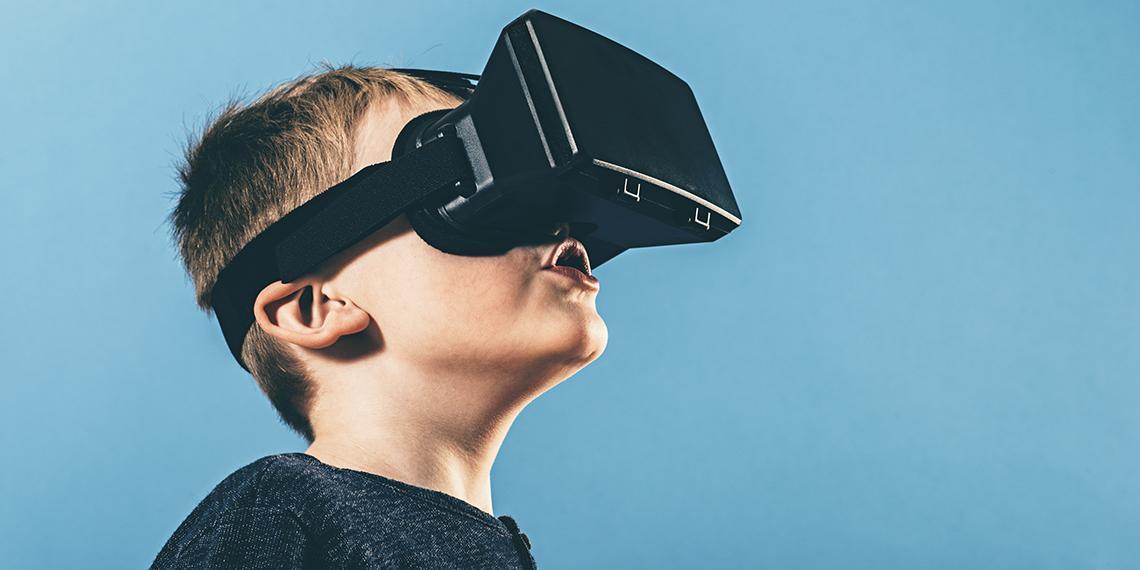 a boy wearing a VR headset