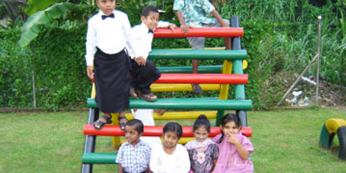 Group of children playing on equipment outside