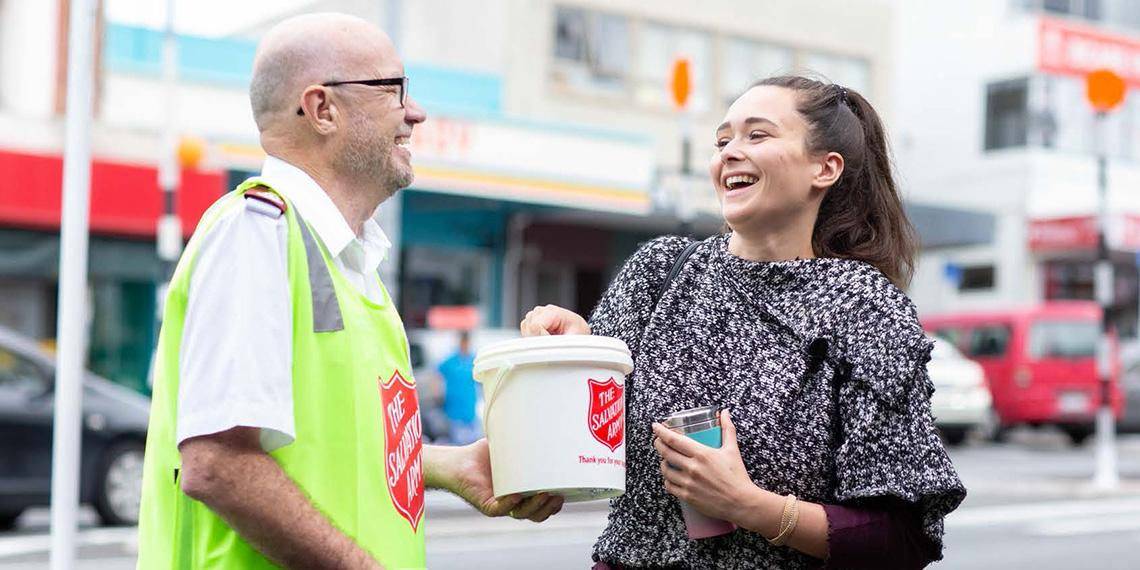 Woman happily giving to the Red Shield street appeal
