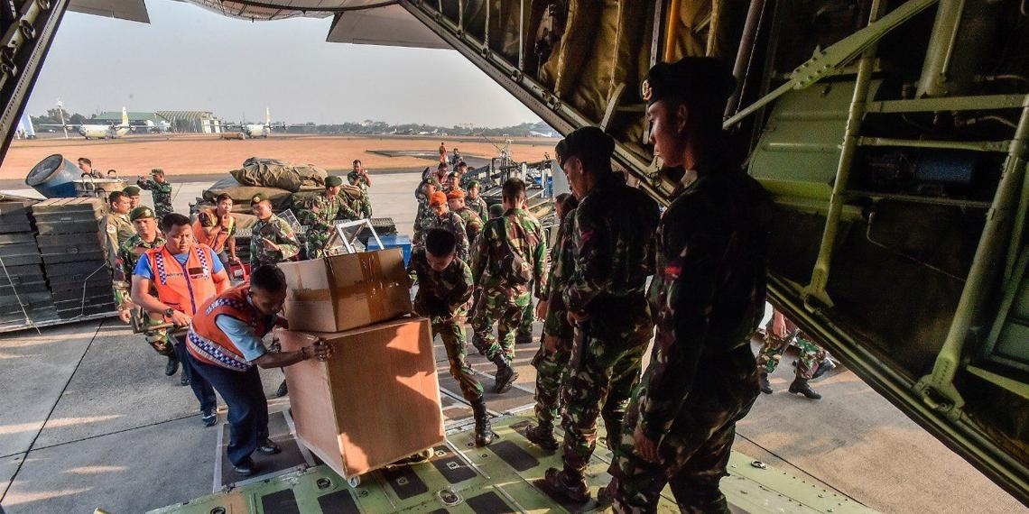 quake relief supplies being loaded onto Indonesian Air force plane