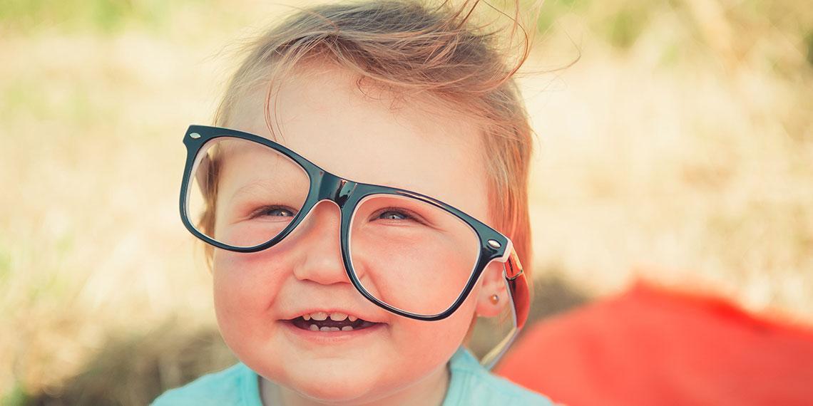 kid wearing glasses funny