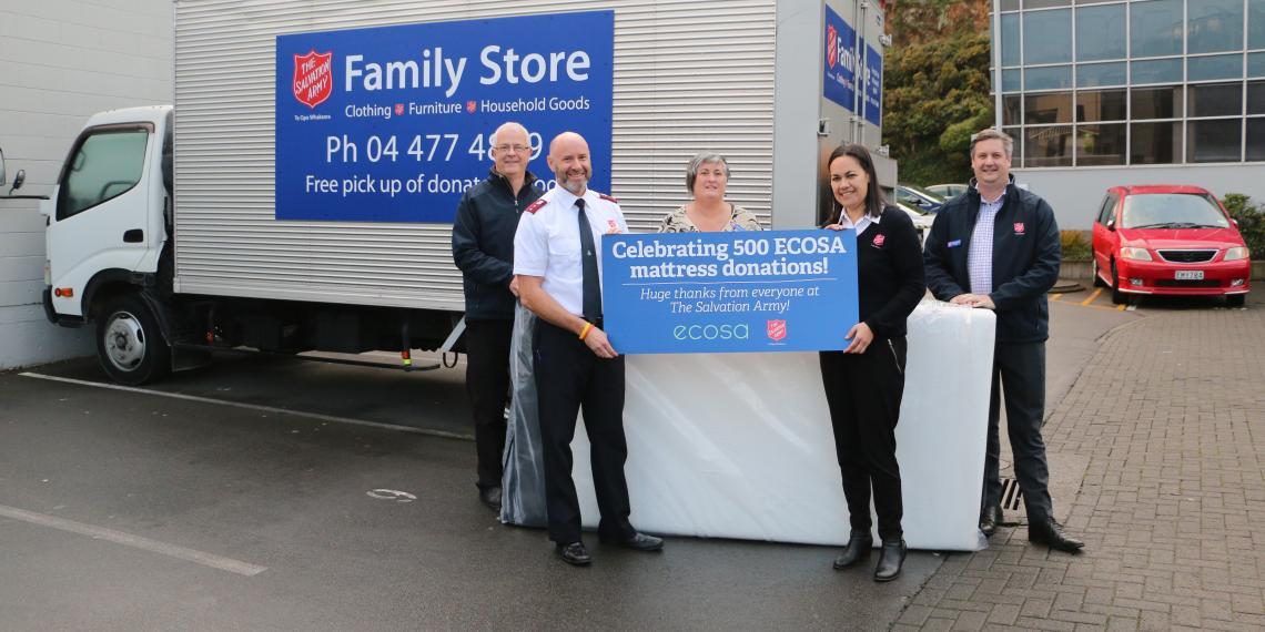 Family Store Team Holding celebration sign