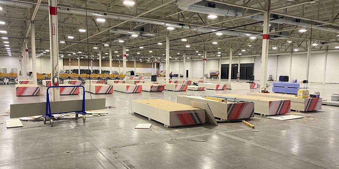 Temporary Salvation Army COVID-19 care facility being assembled at Toronto Congress Centre