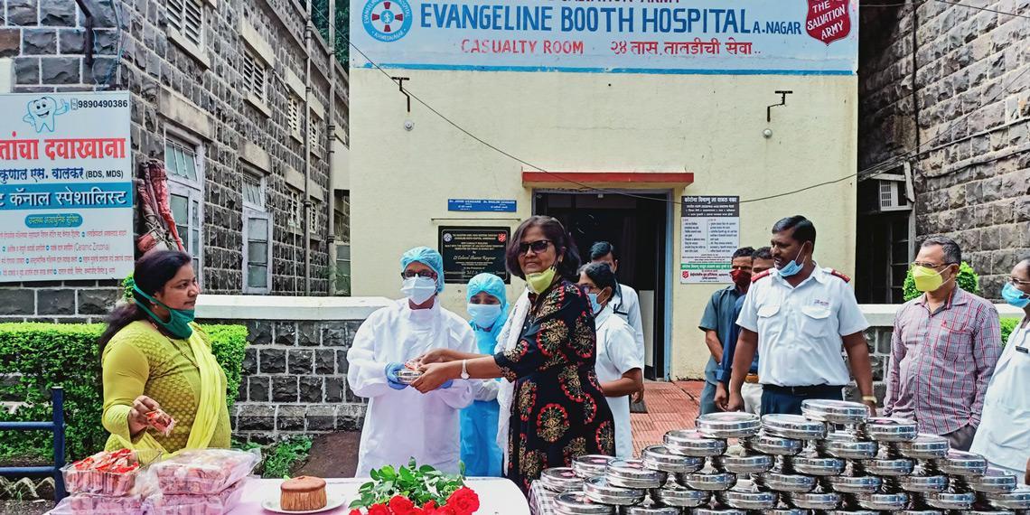 Staff outside Evangeline Booth Hospital