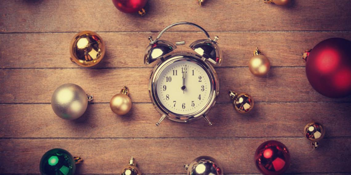 a clock and christmas decorations