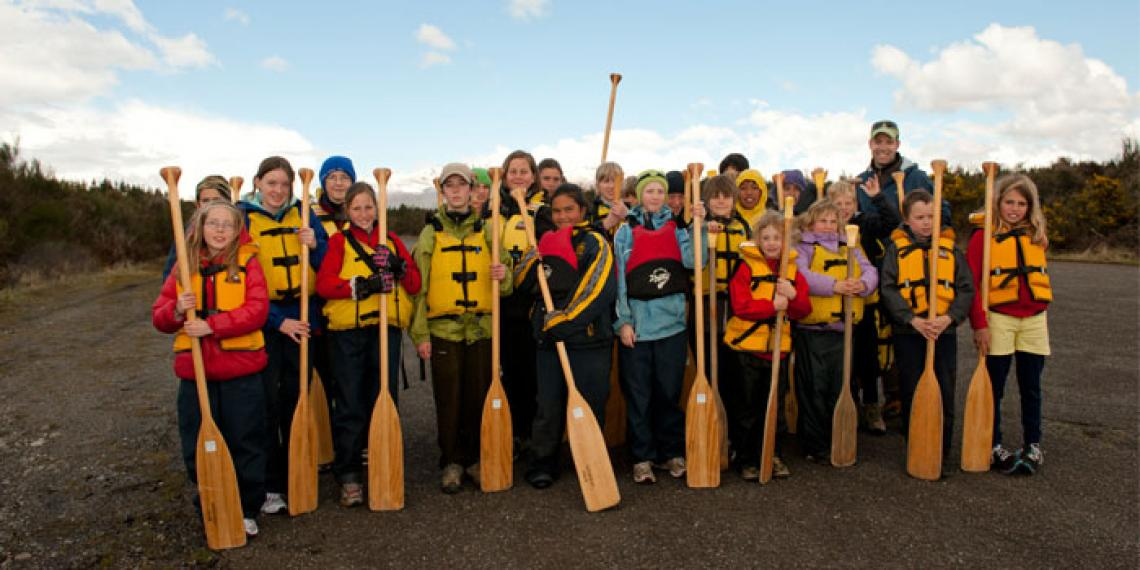 A group of children with paddles at Blue Mountain Adventure Centre
