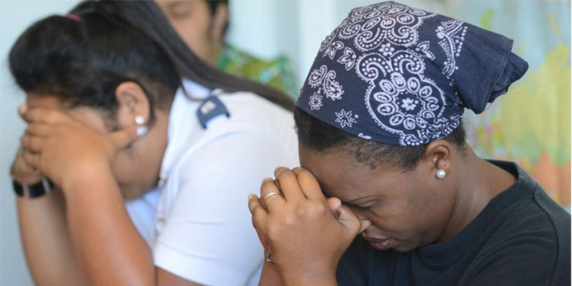Lineni Ulamoleka and Betty Akoteu during staff devotions at The Salvation Army Regional Headquarters in Tonga