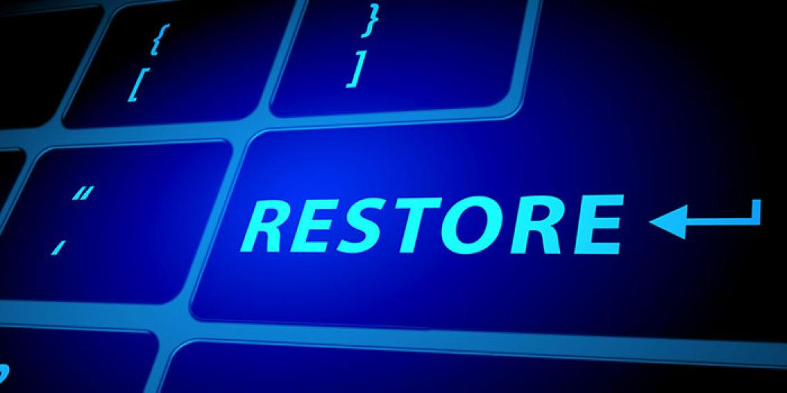 a computer keyboard spelling the word restore