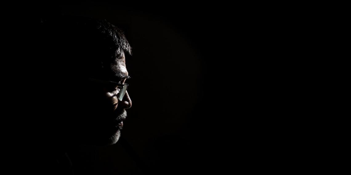 a man in the dark