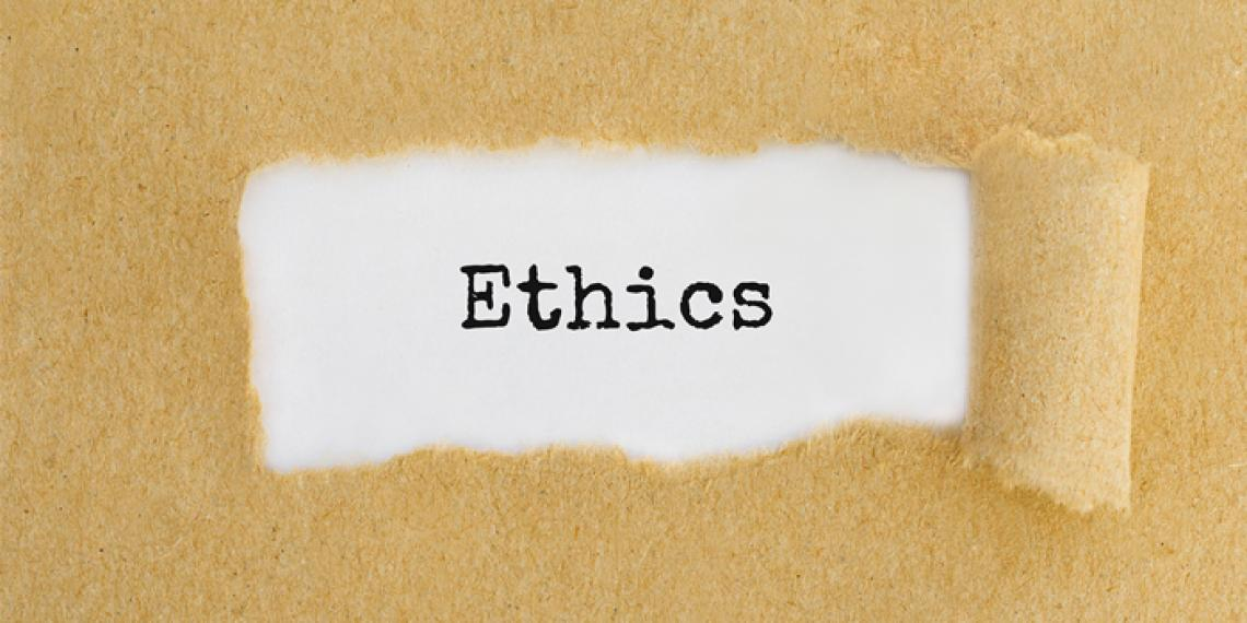 the word ethics written on paper