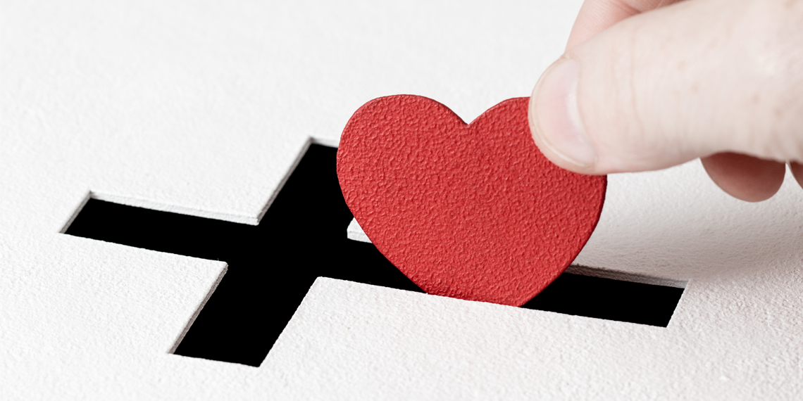 a cross and love heart