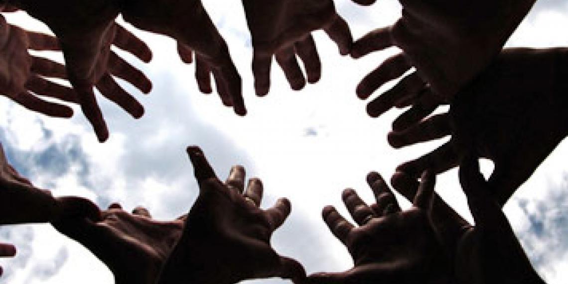 Hands reaching towards the sky