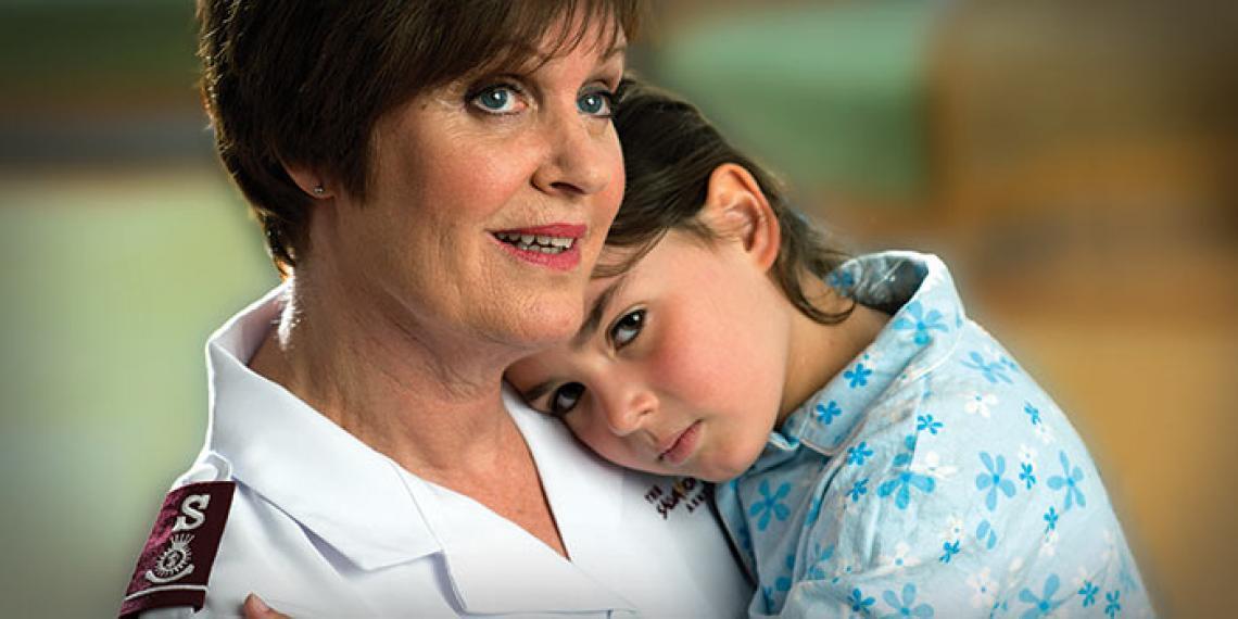 Major Lynette Hutson and child