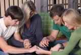 a group of people praying