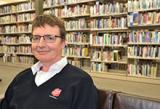 Mike Bryan in the library of Booth College of Mission