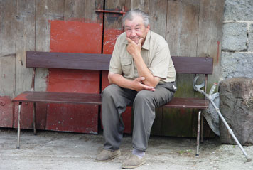 Aged man sitting on bench