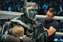 Charlie (Hugh Jackman) and his son, Max (Dakota Goyo) attend to their robot boxer, Atom.