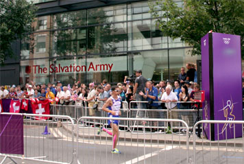 runners pass by IHQ during Olympic mens marathon
