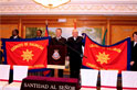 Commissioner Robert Street presents new Spain and portugal Command flags to Majors Mário and Celeste Nhacumba (Portuguese, left) and Lieut-Colonels Gordon and Susan Daly (Spanish)