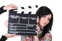 A girl with a movie clapperboard