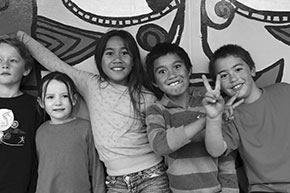 a group of happy Pasifika children